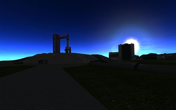 one of the 'pad workers took this photo of Kerbin V ready to go as the sun sets behind the VAB